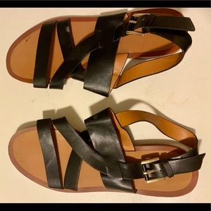 Black and brown vegan leather flat strappy sandals